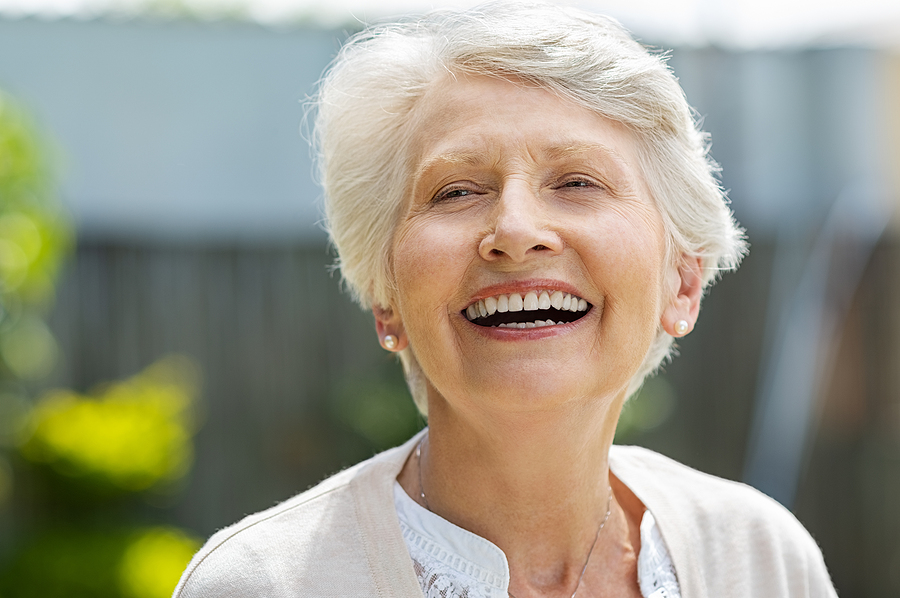 Portrait of a beautiful senior woman laughing outdoor